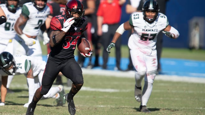 San Diego State running back Greg Bell, left, sprints for a touchdown against Hawaii on Saturday.