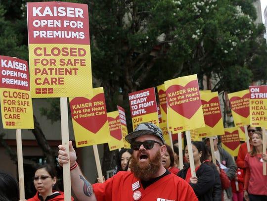 Peter Kilgallen, a registered nurse at Kaiser, center,