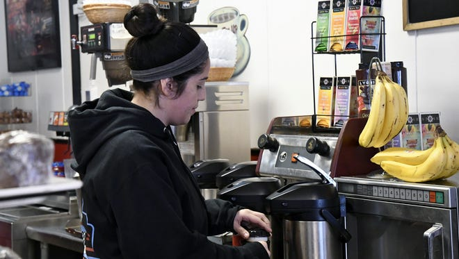 Mama K's Diner employee Catherine Deloera refills a coffee pot on Tuesday morning. If AB 1884 passes, Deloera and other California restaurant servers will have to think twice before handing out plastic straws to patrons.