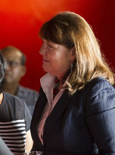 U.S. Rep. Ann Kirkpatrick speaks with supporters at a community event at El Portal restaurant in Phoenix on Sept. 16, 2016.