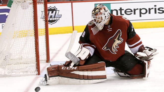 Coyotes goalie Anders Lindback makes a save during the second period of an NHL game against the New Jersey Devils at Gila River Arena in Glendale, Az., on Saturday, January 16, 2016.