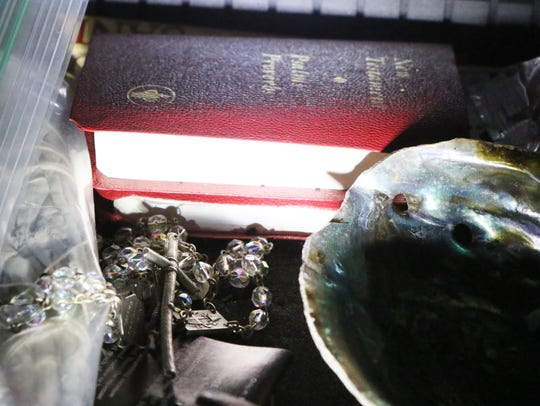 A rosary, a copy of the New Testament and a tortoise