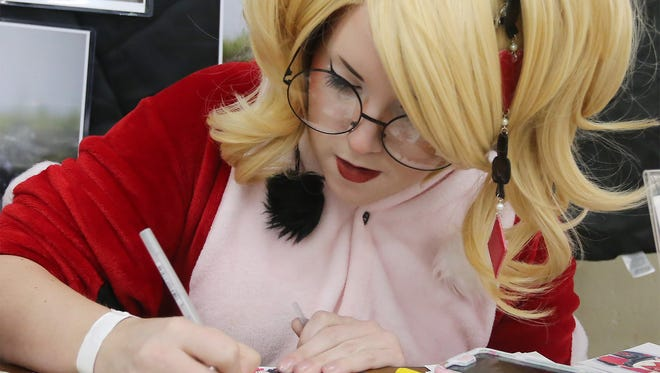 Shannon O'Connell, dressed as Harley Quinn, works on a commissioned drawing during Comic Con Saturday, March 5, 2016, at Old Main. Amanda J. Cain photo