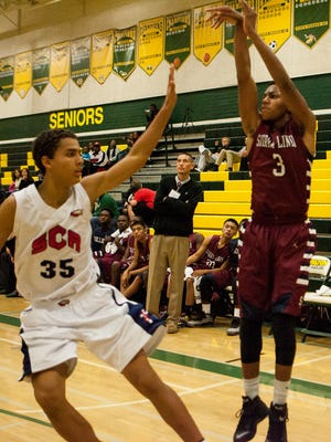 Dontae Aguirre (3) of the Sierra Linda Bulldogs makes a three pointer in the second half of their game against the Scottsdale Christian Eagles during the Horizon Holiday Holiday Hoops Tournament Friday Dec. 19, 2014 in Scottsdale.
