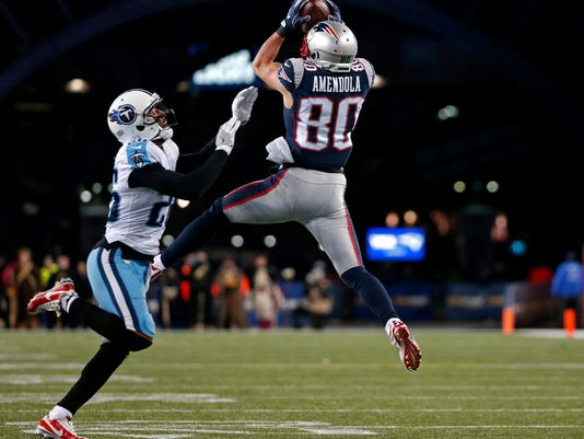 New England Patriots wide receiver Danny Amendola (80) catches a pass in front of Tennessee Titans cornerback Logan Ryan (26) during the second half of an NFL divisional playoff football game, Saturday, Jan. 13, 2018, in Foxborough, Mass. (AP Photo/Michael Dwyer)