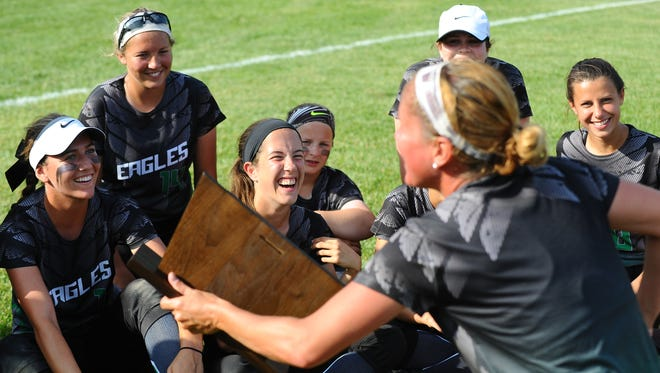 West Deptford softball coach Mandy Schramm talks to her team after a 4-1 over Sterling in Thursday's S.J. Group 2 final pt the team in the state semis. Schramm won a state title in 1996 as a Woodbury player.