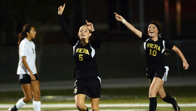 Viera's Jordan Walsh (5) and Brooke Walsh celebrate a first half goal during the 2016 Class 4A state soccer final.