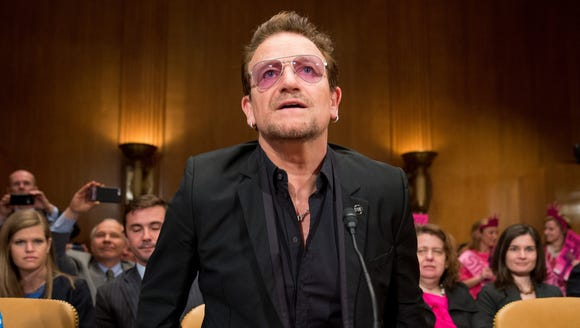 Irish rock star and activist Bono arrives on Capitol