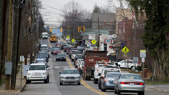 Traffic moves slowly through downtown Weaverville March 17. This image was shot from a position in front of Weaverville Primary School looking north along Main Street. Twisted Laurel can be seen on the right.