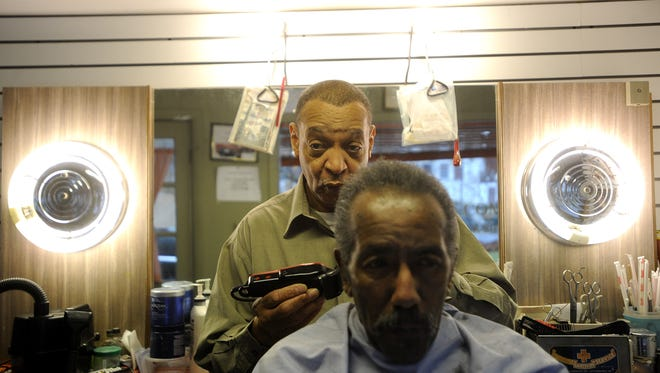 Albert Timberlake cuts hair at Albert's Golden Comb in Staunton on Tuesday, Nov. 22, 2011.