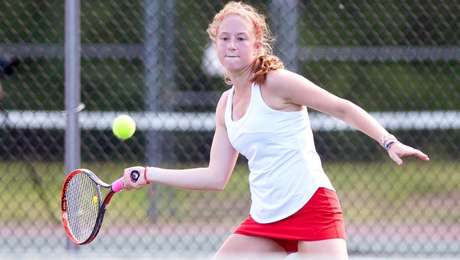 Champlain Valley's Sophie Dauerman lines up a forehand return during a match in 2018.