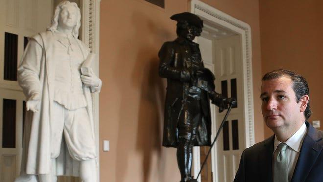 Sen. Ted Cruz, R-Texas, walks through the on the third day of the government shutdown.