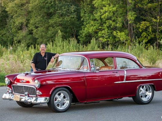Peter Daniele of Madison rebuilt his 1955 Chevy 210 Sedan as a racecar with 17 coats of Candy Apple Red lacquered paint. The car cost him $35 in 1971, when he was 15 years old.