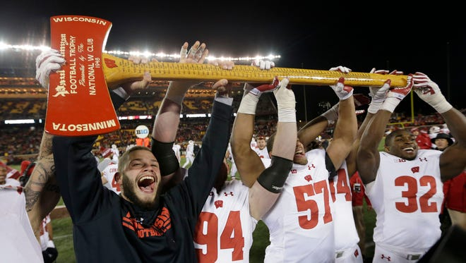 Wisconsin Badgers football players, including injured linebacker Jack Cichy (far left), celebrate with the Paul Bunyan ax after the 31-0 win over the Minnesota Golden Gophers  at TCF Bank Stadium in Minneapolis on Nov. 25.  UWGRID UWGRID26 - Wisconsin Badgers players, including injured linebacker Jack Cichy (48), far left, celebrate with the Paul Bunyan ax after the 31-0 win vs. Minnesota Golden Gophers football game at TCF Bank Stadium in Minneapolis, Minnesota on Saturday, November 25, 2017. -  Photo by Mike De Sisti  / Milwaukee Journal Sentinel