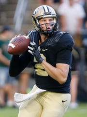 Purdue quarterback Elijah Sindelar looks to pass against  Minnesota Saturday, October 7, 2017, at Ross-Ade Stadium. Purdue defeated Minnesota 31-17 in a game delayed by weather.