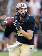 Purdue quarterback Elijah Sindelar looks to pass against