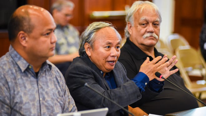 Local businessman Sedfrey Linsangan, center, total cost cutting measures aimed at addressing the government's $67M budget shortfall, would result in only a $2M shortfall, during his testimony to lawmakers during a public hearing at the Guam Legislature on Thursday, Mar. 8, 2018.