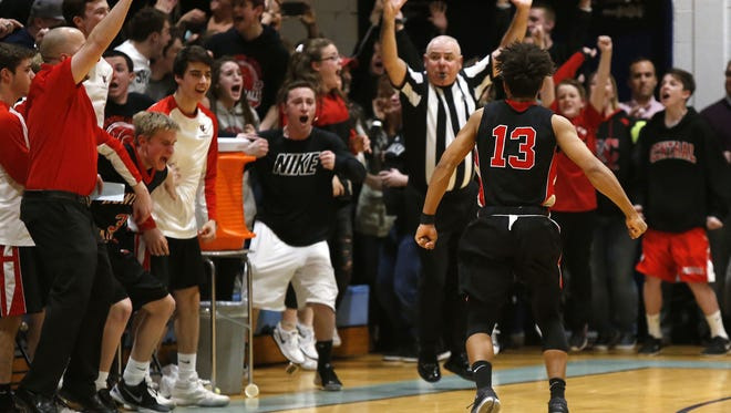 Anthony McDowell(13) of Hunterdon Central reacts after making a three point shot to defeat Freehold Twp. 41-39 during NJSIAA Central Group IV final at Freehold Twp. High School.  Freehold Twp., NJ.