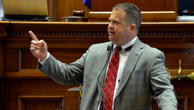 Senator Lee Bright argues points for keeping the flag on the Statehouse before the final vote on Tuesday, July 7, 2015.