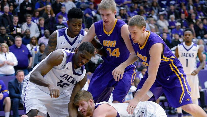 Northern Iowa forward Seth Tuttle, bottom left, struggles with Stephen F. Austin State forward Bobby King, left, and guard/forward Thomas Walkup to keep the rebound under the basket with other players looking on during the first half of an NCAA college basketball game Tuesday, Nov. 18, 2014, in Nacogdoches, Texas.