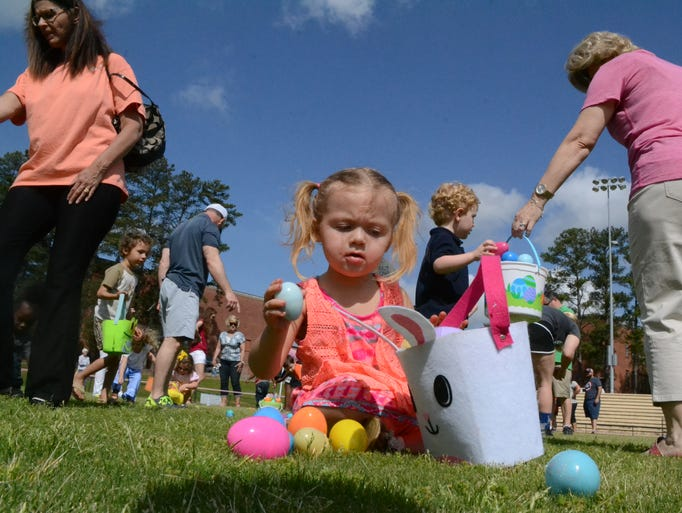Athena Delliveneri, 2, is determined to fit the Easter