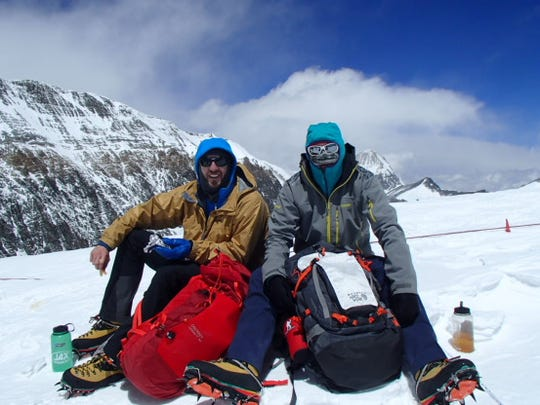 Andy Anderson, left, and his cousin John Anderson take a break on the north ridge of Mount Everest during an acclimation run to prepare for the higher elevations.