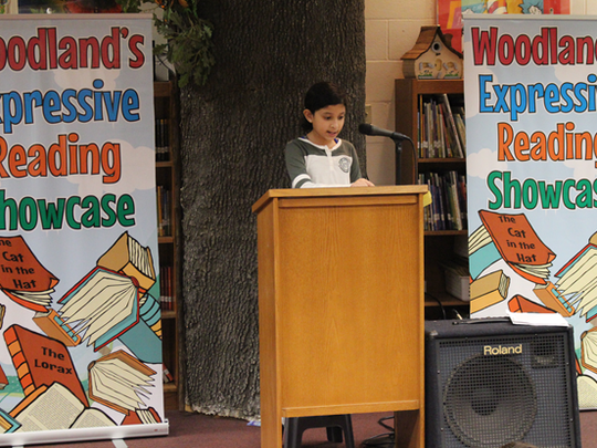 """Woodland student, Eesha Jagadeesh reading """"Noodle Magic"""" by Roseanne Greenfield Thong"""