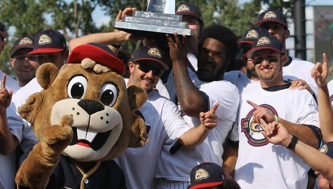 The Birmingham-Bloomfield Beavers celebrate after claiming the 2017 USPBL championship Sunday at Jimmy John's Field.