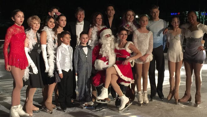 The cast of the ice show with Santa.