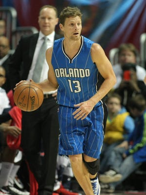 Orlando Magic guard Luke Ridnour (13) dribbles the ball against the Atlanta Hawks in the second quarter at Philips Arena.