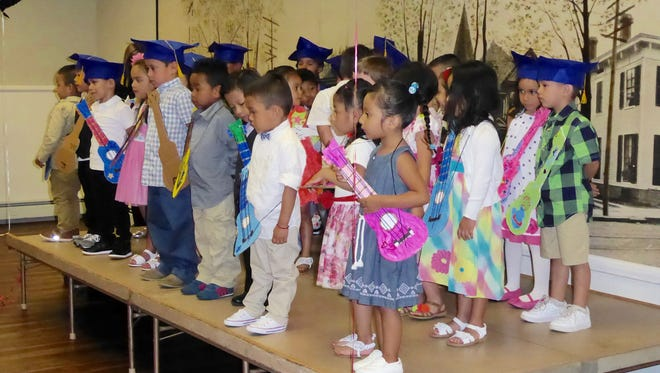 "On Friday, June 17th,  three-, four- and five-year-old students from El Primer Paso in Dover celebrated their graduation to kindergarten or moving up to the next year of preschool.    An overflow crowd of proud family and friends filled the recently renovated downstairs hall at First Memorial Presbyterian Church to watch the students enthusiastically demonstrate their knowledge of the alphabet, numbers, and colors through song, and accept their diplomas.   Teacher Johanna Toro's photo booth added extra fun as students posed with signs declaring:  ""Preschool Rocks"" and ""Kindergarten Here I Come"".     El Primer Paso would like to extend a special thank you to First Memorial Presbyterian for the use of their facility for this memorable day."