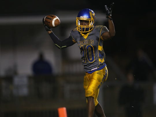 Rickards' Javon Wooten celebrates a touchdown during their FHSAA playoff game against Panama City's Bay High School at Cox Stadium on Thursday, Nov. 10, 2016.