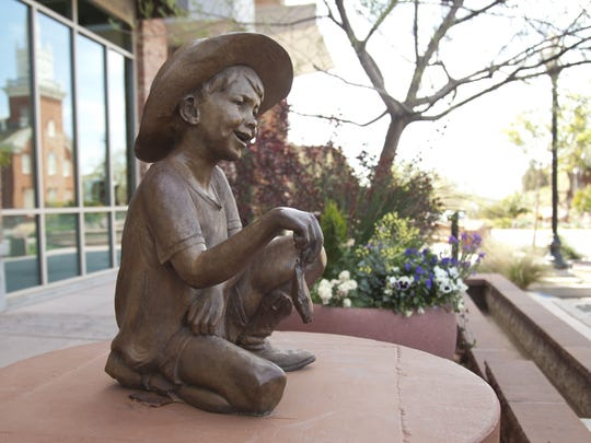 """""""Fish Tales,"""" by artist Dan Hill, sits on a pedestal in downtown St. George on Tuesday. The piece is one of two dozen outdoor sculptures included in the Art Around the Corner art show. New pieces are slated to rotate in this weekend, with the new show opening on Saturday."""