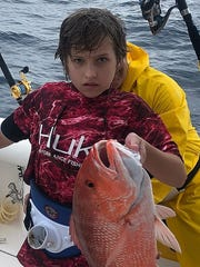 A young angler caught and released this red snapper