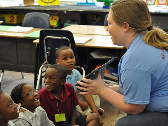 W.O. Hall teacher Karen Wiggins shows her second-grade class how to use their new iPads in class Friday morning.