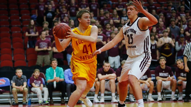 Carroll Kuemper Catholic's Chase Netusil looks for an open pass while being guarded by Western Christian Hull's Josh VanLingen during Tuesday's game of the Class 2A Iowa Boys' High School State Basketball Tournament at Wells Fargo Arena in Des Moines, Tuesday, March 8, 2016.