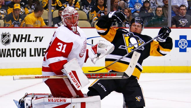 The Penguins' Patric Hornqvist collides with Red Wings goalie Jared Coreau in the second period.