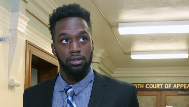 FILE - In this March, 1, 2017, file photo, former Baylor football player Sam Ukwuachu leaves the 10th Court of Appeals following arguments in Waco, Texas. An appeals court has overturned the conviction of the former Baylor football player whose case helped give rise to the sexual assault scandal that engulfed the nation's largest Baptist school. The Texas 10th Court of Appeals said in a ruling Wednesday, March, 22, 2017, that text messages should not have been excluded from the testimony in Sam Ukwuachu's 2015 trial. (Jerry Larson/Waco Tribune Herald via AP, File)