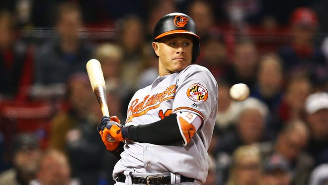Manny Machado dodges a high pitch in the fourth inning thrown by Chris Sale.