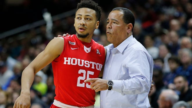 Feb 28, 2016; Storrs, CT, USA; Houston Cougars head coach Kelvin Sampson talks with guard Galen Robinson Jr. (25) as they take on the Connecticut Huskies during the second half at Harry A. Gampel Pavilion. Houston defeated UConn 75-68. Mandatory Credit: David Butler II-USA TODAY Sports