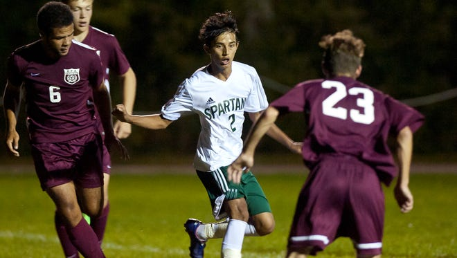 Winooski's Lek Nath Luitel, center, dribbles around two BFA-Fairfax defenders during Thursday night's boys soccer game in Winooski.