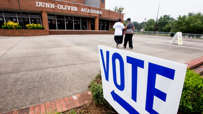 Voters make their way into the polling station at the Acadome in Montgomery, Ala. on Tuesday July 17, 2018.