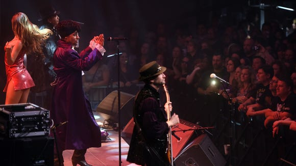 Jason Tenner performs as Prince during Purple Reign,