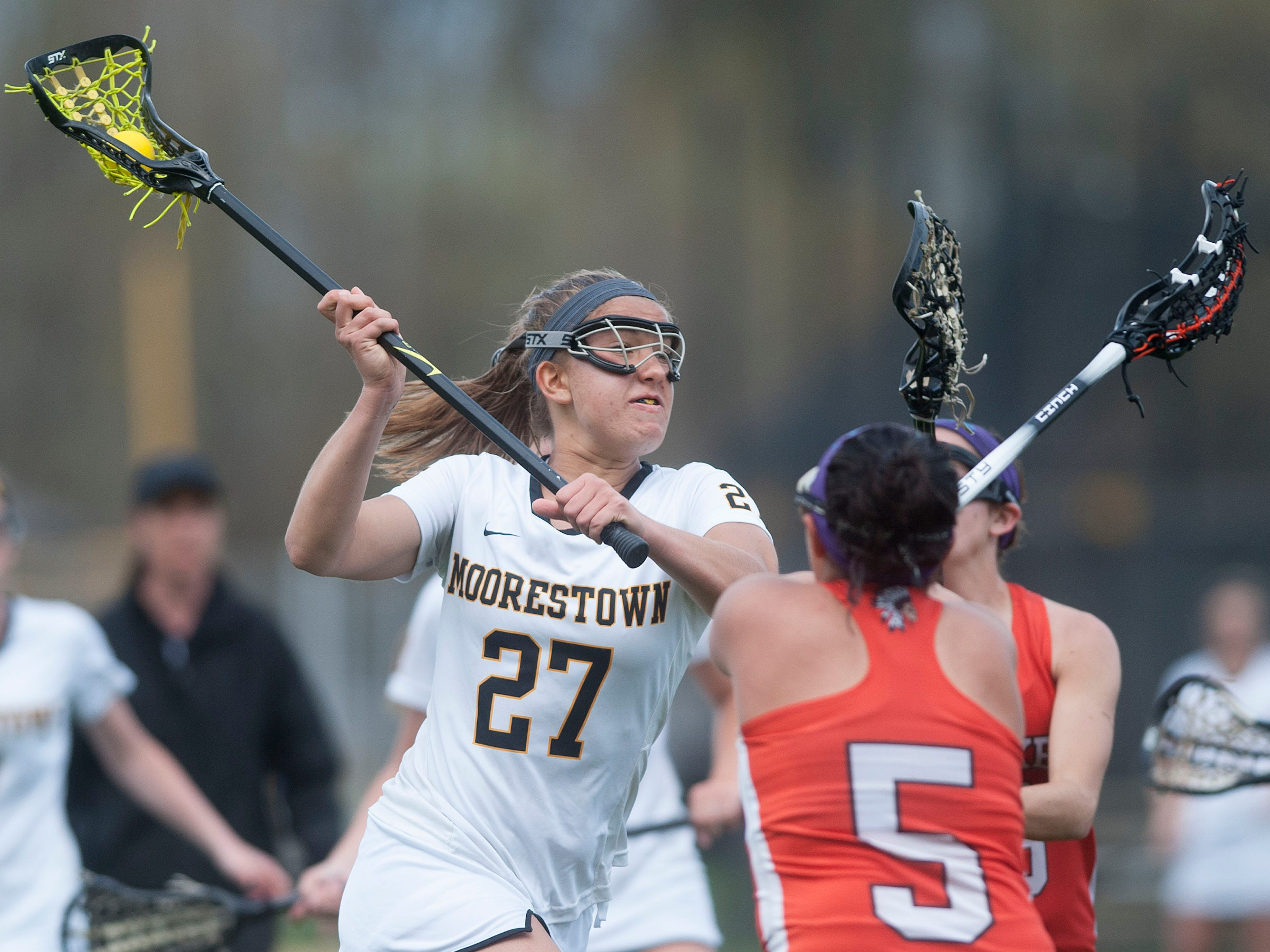 Moorestown's Alex O'Donnell, left, shoots over Cherokee's Lisa DiLullo, center, and Cherokee's Savannah Singer, right, during the 1st half of Wednesdays game played in Moorestown. 04.22.15