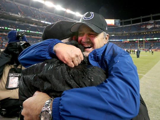 Indianapolis Colts head coach Chuck Pagano his his father Sam Pagano, following their 24-13 win over the Denver Broncos in the 2014 playoffs.
