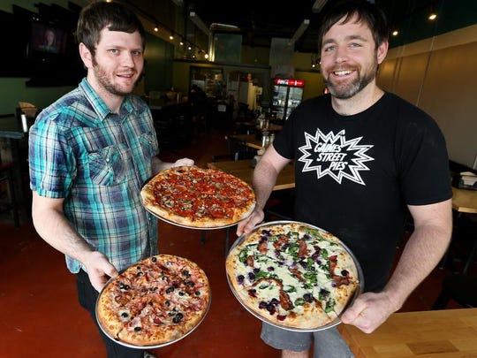 Jeremy Matlow, left, and Ryan Smith, the same pizza brothers that brought Tallahassee Gaines Street Pies have now opened up Midtown Pies in the Midtown District.