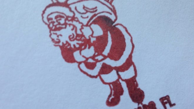 At the Christmas Post Office, customers can stamp their cards with inked holiday greetings and get a Christmas postmark from ZIP code 32709.
