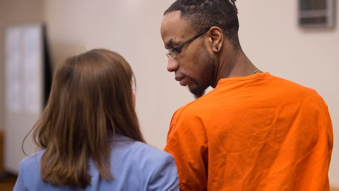 """Jeffery Etheridge looks at his attorney, Erin Crowgey after being sentenced to life in prison without the possibility of parole during his sentencing hearing at the Larimer County Justice Center on Monday, February 26, 2018. Etheridge plead guilty to the murder of Heather """"Helena"""" Hoffmann whose body was found in Sheldon Lake in City Park last June."""