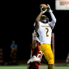 8/30/13 - 0827130556tlb PNI0831-spt chaparral - Saguaro High receiver Christian Kirk (cq) makes a catch over Chaparral High defensive back Kurt Shughart (cq) during the first half of the high school football game at Chaparral High School (cq) in Scottsdale (cq) on Friday, August 30, 2013. (cq) David Wallace/The Arizona Republic