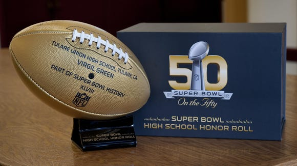 Tulare Union High School received a gold football from the National Football League for former student Virgil Green's participation in Super Bowl XLVIII. Green is also expected to play for the Denver Broncos in Super Bowl 50 on Sunday at Levi's Stadium in Santa Clara.